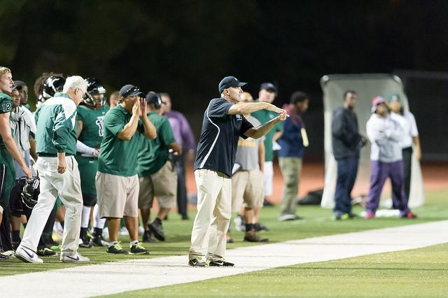 Head Coach Mike Carr is trying to explain a signal to his players in this game against Modesto City College on Sept. 19, 2014 in Pleasant Hill. Andrew Barber / The Inquirer