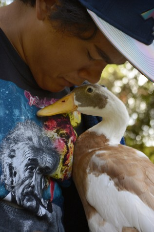 Slideshow: Brent Andrada and Yoda the duck