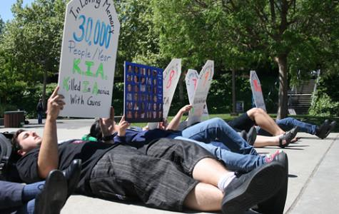 Protestors from the Brady Campaign lie down at the DVC main Quad for the one year anniversary of the Virginia Tech massacre. ()