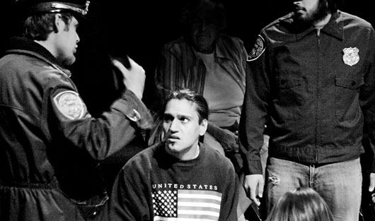 Malik, played by Zarif Kabier Sadiqi, is confronted by two Homeland Security Agents in the play
