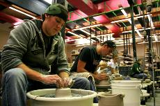 Ceramics student Jim Jordan works on potter piece in the ceramics studio. ()
