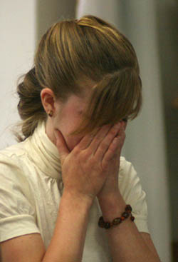 Lindsay St. Hill cries movments after the Election Commitee found the UAID coalition guilty of two election code violations. (Zach Becker)