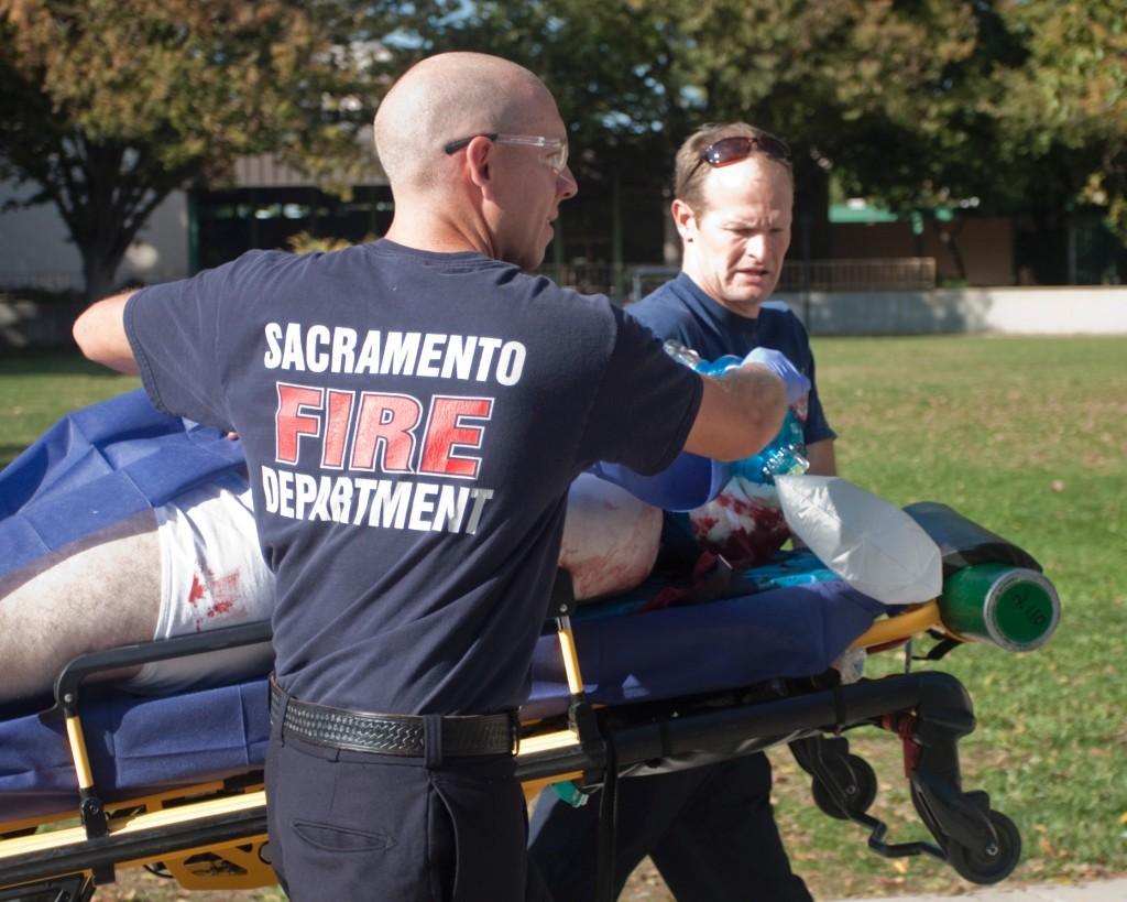 """Scott Hawkins, a victim in the recent campus killing at Sacremento State University, being taken awayby paramedics. This photo, picked up by the Associated Press, was taken by former Inquirer phot chief Adalto Nascimento, now online editor at """"The State Hornet."""""""