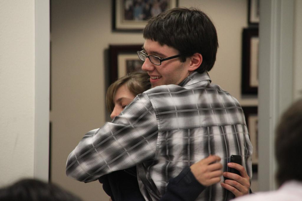 Brian Donovan, vice president of legislative affairs-elect, hugs student Roxy Cappelini after all charges were dropped at the May 4 Election Committee meeting. (Photo by Courtney Johnson/The Inquirer 2010)