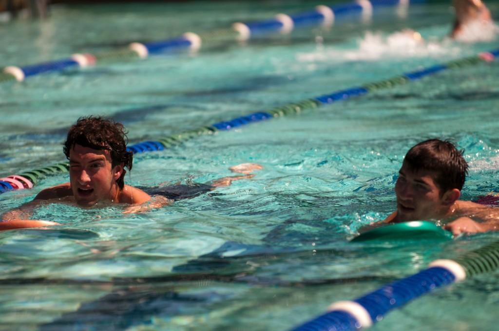 Jake Patterson, left, and Sam Barton swim laps at the DVC pool during the triathlon training class on March 28, 2011. (Stevie Chow/The Inquirer)