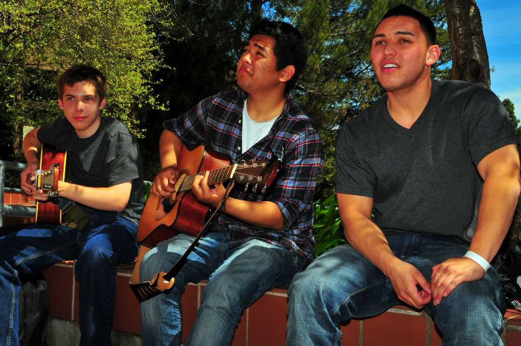 Aaron Miller (left) Kevin NIcholas DeGuzman (center) and Colling Domingo (Right) think of the next song to perform. ()