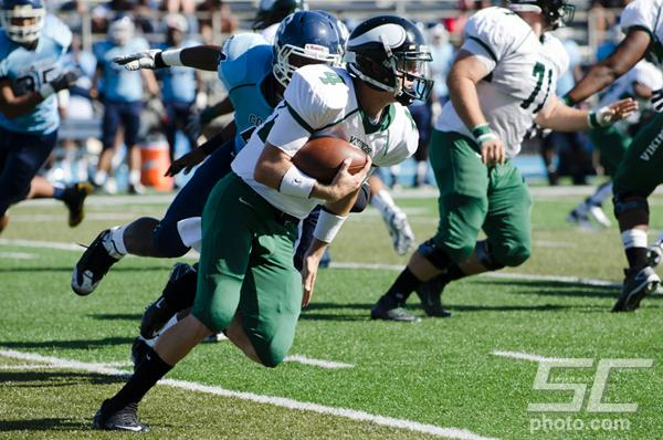 Quarterback Spencer Van Brunt tucks the ball and runs up field at Contra Costa College. (Stevie Chow / The Inquirer)
