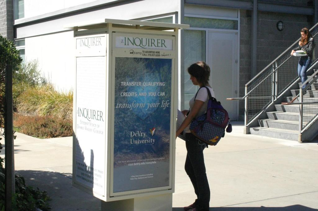 Jessica Fay looks with intent at the Inquirer Kiosk. (Sean Wilkey / DVC Inquirer)