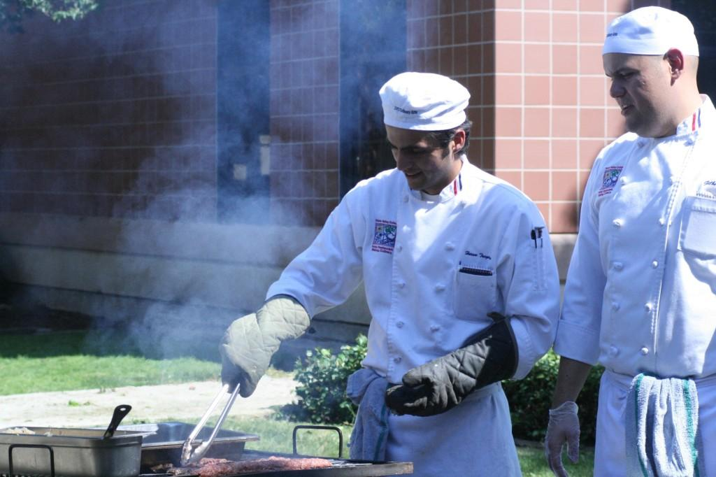 Left to right; Harun Tasgiran and Gilberto Rios watch over the BBQ for the Norseman. (Danielle Barcena / DVC Inquirer)