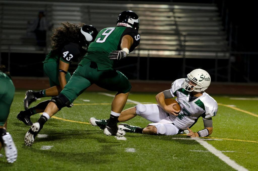 Linebackers Ryan Gomez, front, and Siuea Vaesau pursue Shasta's fallen quarterback at the Sept. 9 game.. (Stevie Chow / The Inquirer)