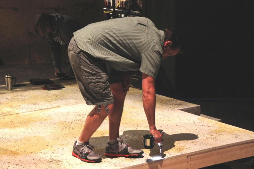 Scott Heiden works on the set for the upcoming play Romeo and Juliet. (Danielle Barcena/ DVC Inquirer)