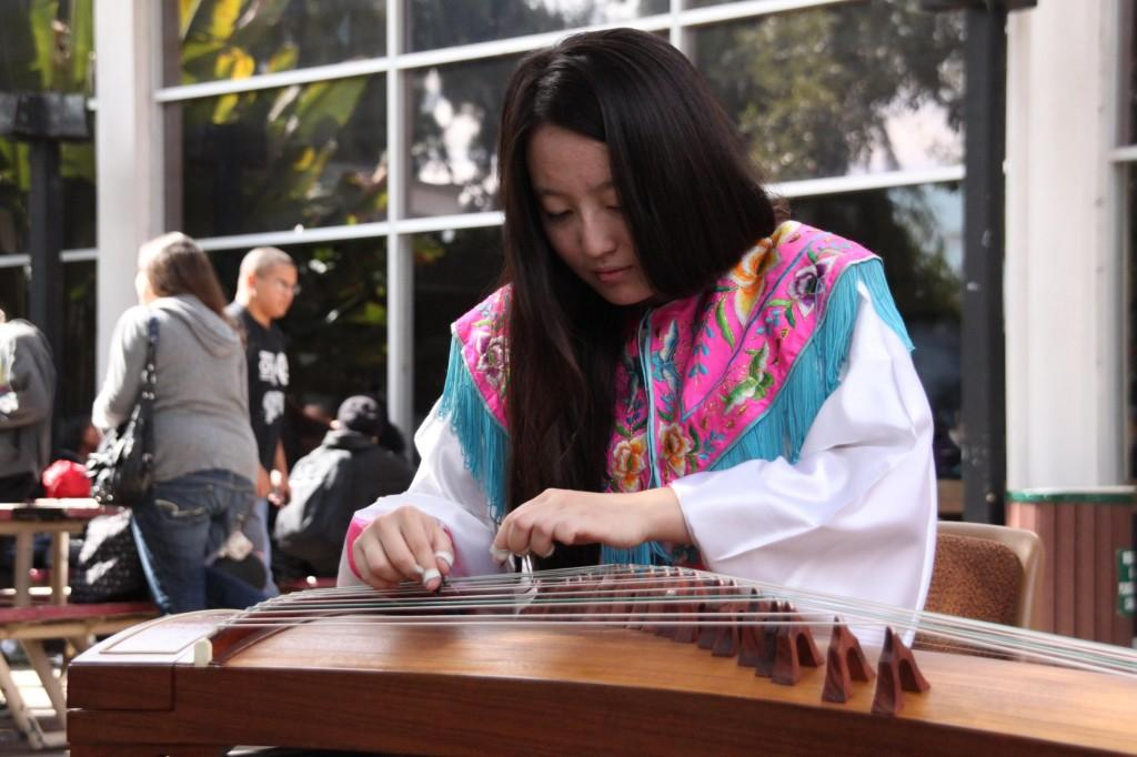 Ling Tong Meng plays the Guzheng for the Moon Festival. (Danielle Barcena/ DVC Inquirer)