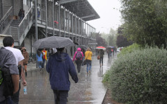Rain drenched students rush to class during the brief 10 minute passing period.