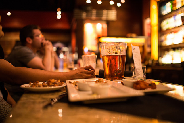 Beer and buffalo wings at the bar at BJs Restaurant and Brewhouse in Pleasant Hill, California on Tuesday, May 5, 2015.