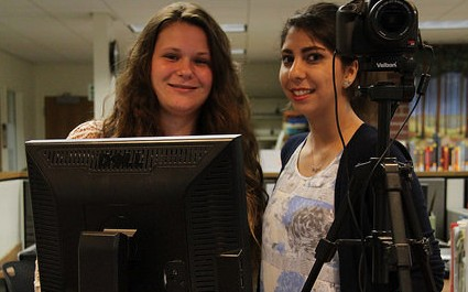Deven Meadows and Pariya Farzami, working the main desk in the Library, would be happy to issue you a student ID.
