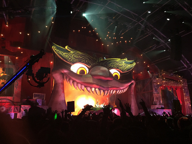 The menacing dragon eyes watch ravers in Slaughterhouse, the main stage at Escape All Hallows Eve where Chainsmokers was performing.