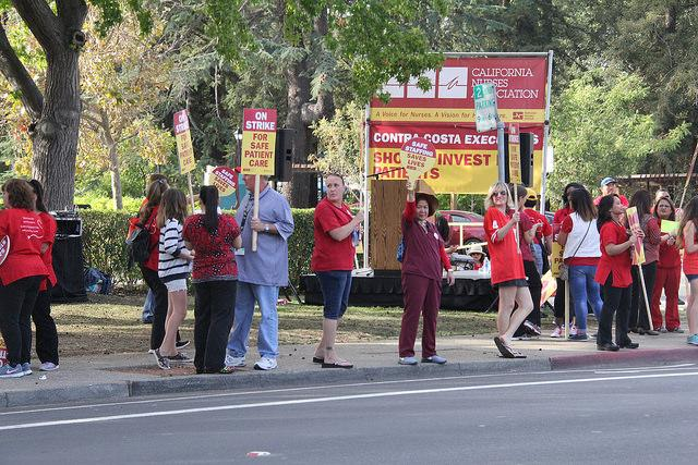 Nurses from the Martinez County Hospital strike in front of the hospital entrance on Wednesday  7.