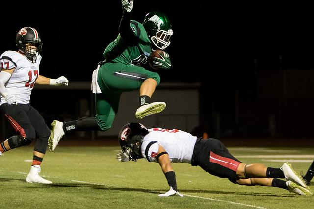 DVC fullback Rodrick Sweeney (46) jumps over Foothill defensive back Dustin Nascimento (8) to carry the ball just one yard short of the endzone in a game between DVC and Foothill College at DVC in Pleasant Hill, Calif. on Friday, Oct. 23, 2015. The Vikings won 52-13.