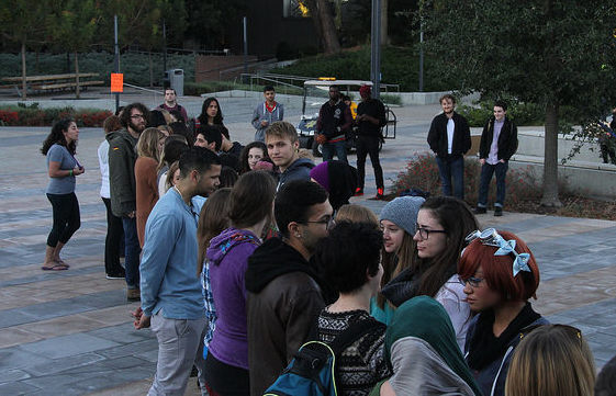 Students participate in a step up, step back  activity lead by a key speaker during the Womens Empowerment DVC Take Back the Night Rally in the DVC quad, Nov. 4.
