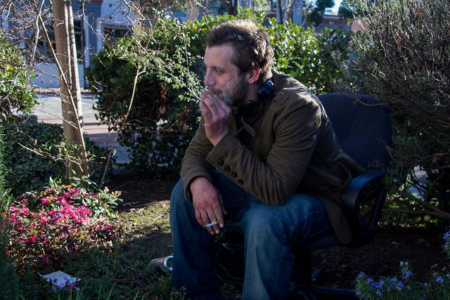 Chris Harless a homeless man from Martinez sits smoking a cigarette while discussing the new ordinances in Martinez on Feb. 8, saying that the cops stop him at least twice a day.