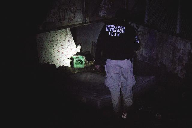 Doug Stewart from the Contra Costa County Homeless Outreach Program checks a water run off tunnel in North Richmond to make sure no one was trapped by the rushing water on 5 March.