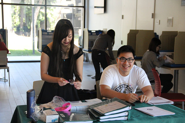 Wesley Xia and Ashley Leung, both ASDVC members sit at the polling booth during the elections April 13.