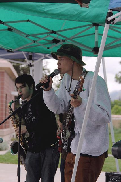 Trevor Strohl, 18 Saxophone player, and Miles Davis, 22 bass player play to a crowd of DVC students during the United Faculty BBQ on April 27.