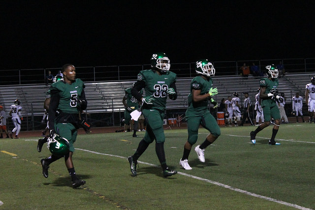 Shane Morris, Damarius Muchison Sam Allan and Juiwan Brown, left to right, take the field against College of the Sequoias on Sept. 17, 2016 at Viking Stadium. The final score was Vikings 44, Giants 28. Nikki Moylan / The Inquirer