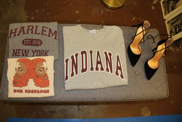 Pointed lace up heel, graphic t shirts and university apparel at Goodwill in Pleasant Hill