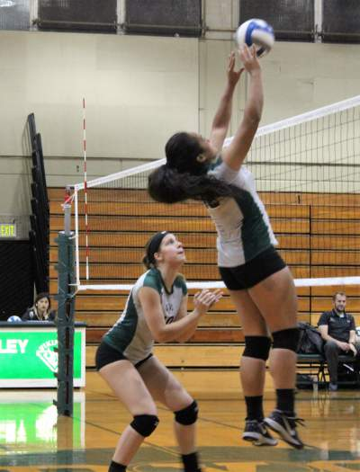 Outside hitter Daisy Manoa and middle hitter Ashley Dixon playing against Folsom Lake College Friday Oct. 14