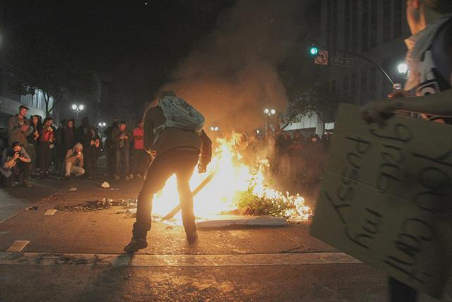 Fires burn during the anti-Trump protest in Oakland on Nov. 9, 2016