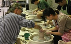 Ceramics instructor Mark Messenger helps Emma Wu craft a piece on the throwing wheel on November 3, 2016.