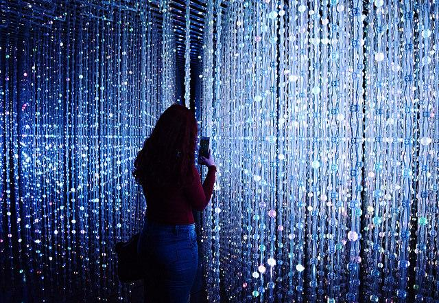 Noora Nimir taking a photo of the Crystal Universe.