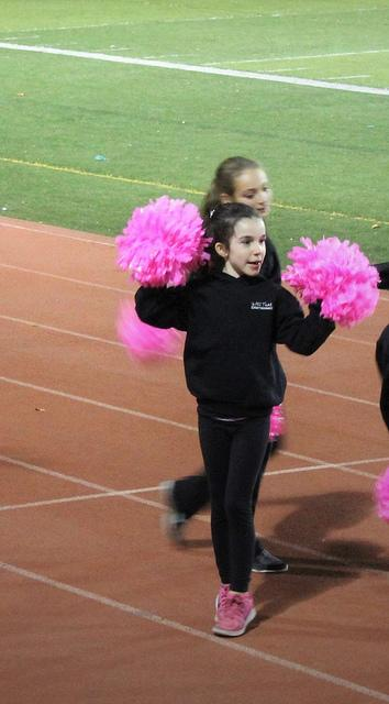 Team Pink Dance, lead by Program Director: Cassandra Montgomery, cheer for DVC on the sidelines while raising awareness about their breast cancer research fundraiser.