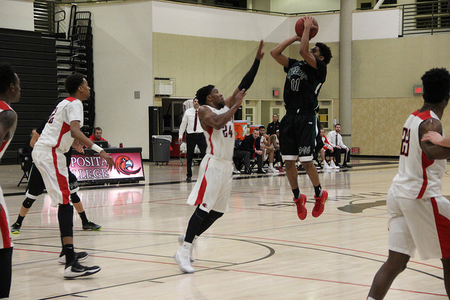 DVC's Rodney Pope elevating over Caleb Baskett for the jump shot.