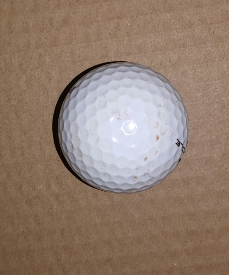 One of many golf balls not utilized by Diablo Valley College's athletes department in the spring of 2017.