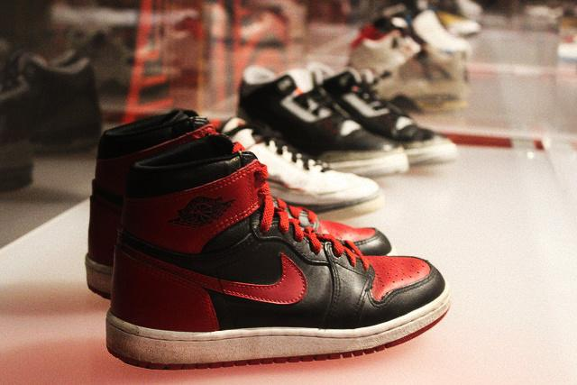 The famous banned colorway of the Air Jordan I infant of the Air Jordan II and Air Jordan III on display at the Rise of Sneaker Culture exhibit in Oakland.