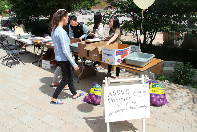 Karen Suryajaya and Asami Higuchi of the ASDVC food pantry ad hoc committee gathering signatures at the Spring Festival Apr. 19, 2017.