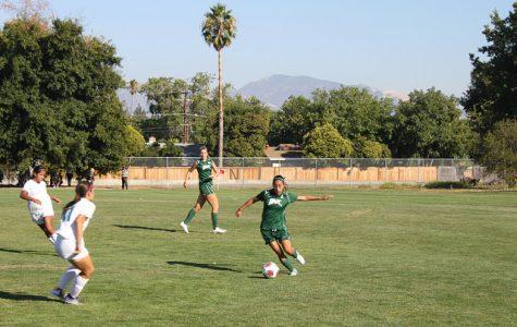 Defender Marlene Huerta moves the ball up the field against Clovis on Aug. 25, 2017.
