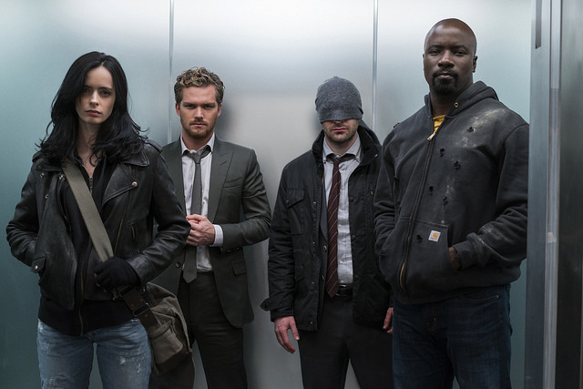 Jessica Jones (Krysten Ritter), Iron Fist (Finn Jones), Daredevil (Charlie Cox), and Luke Cage (Mike Colter) as Marvel's Defenders, available now on Netflix.