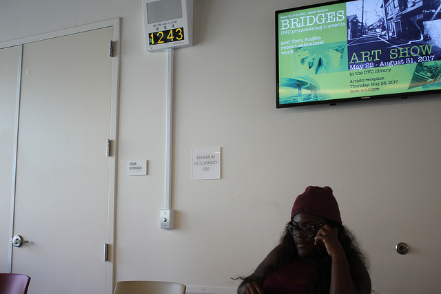 Jade Mayes sits next to the new PA system installed in the cafeteria on Aug. 23, 2017.