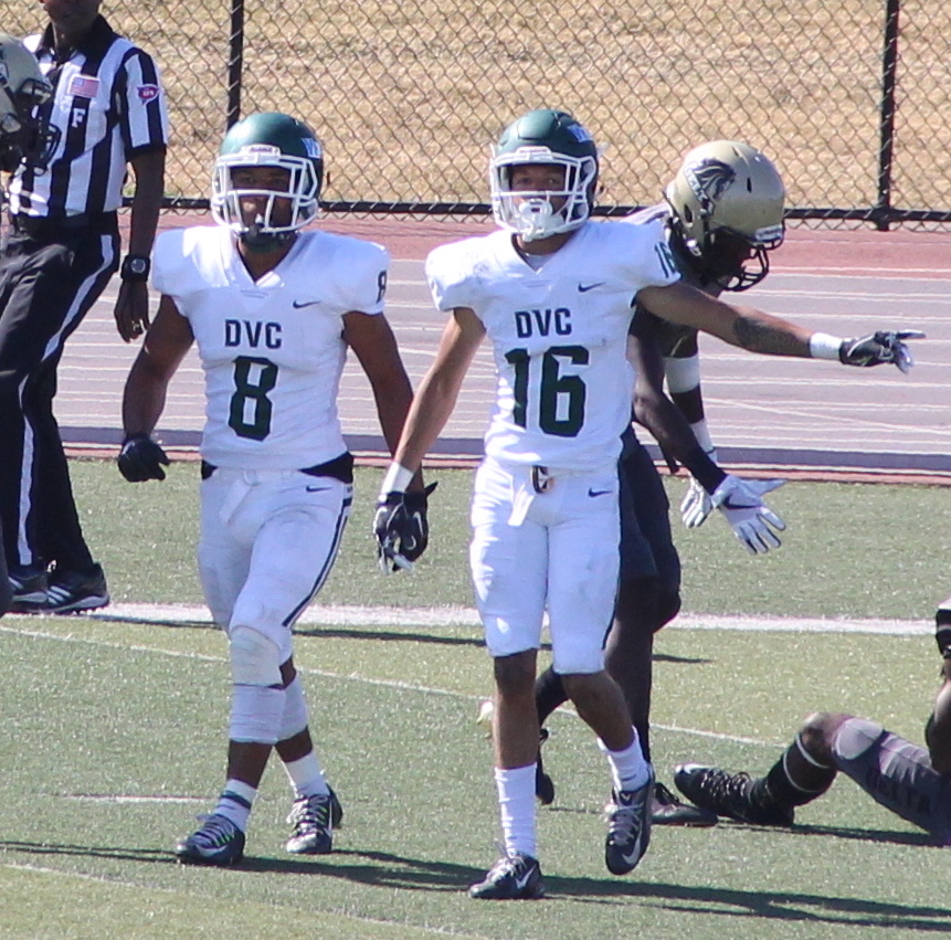 Wide+receivers+Cameron+Norfleet+%288%29+and+Brandon+Perrilliat+%2816%29+head+back+to+the+huddle+after+converting+a+first+down+against+Delta+College+in+Stockton%2C+California+on+September+30%2C+2017.