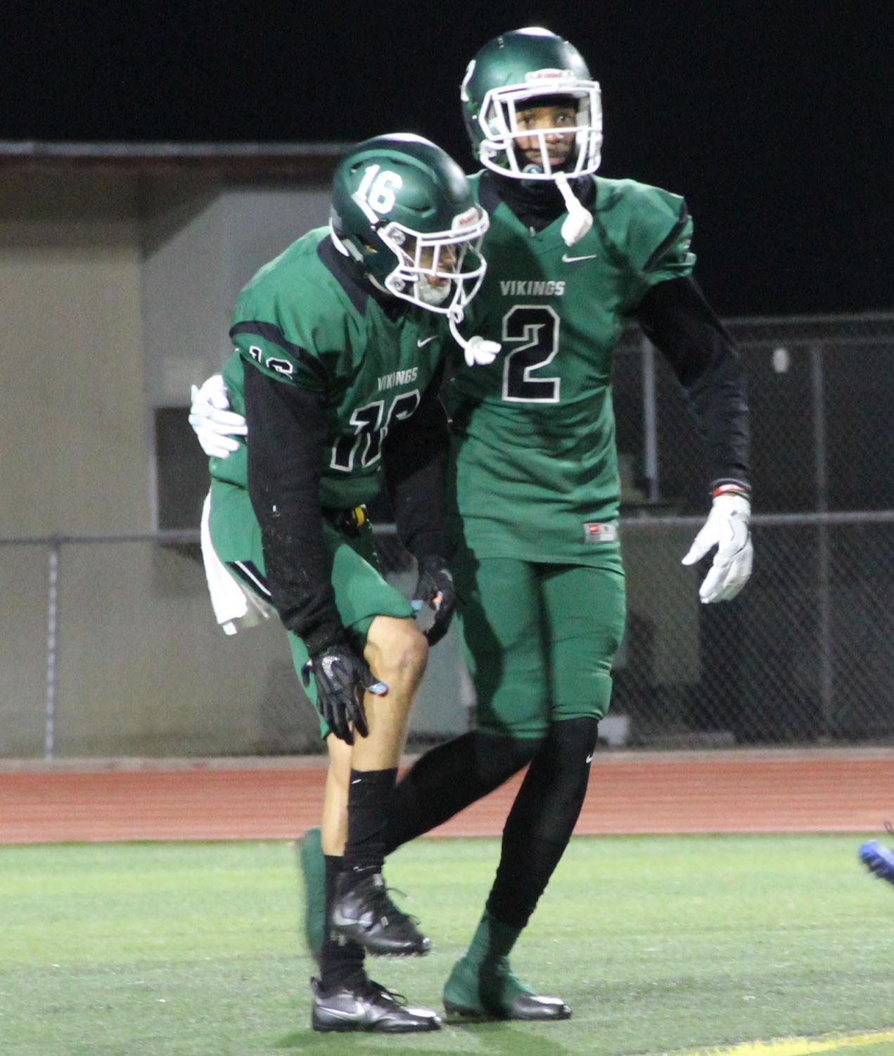 Wide receivers Brandon Perrilliat (left) and Antwuin Prowes (right) walk back to the sideline in their game against College of San Mateo at Diablo Valley College in Pleasant Hill, California on November 10, 2017.