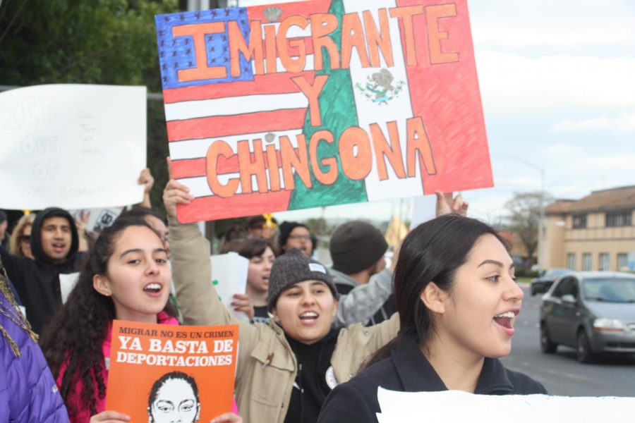 DVC Students Nayely Jauregui (Middle) and Celeste Rios (Left) march along Monument Blvd with other protesters to speak out against the recent ICE raids throughout Bay Area communities.