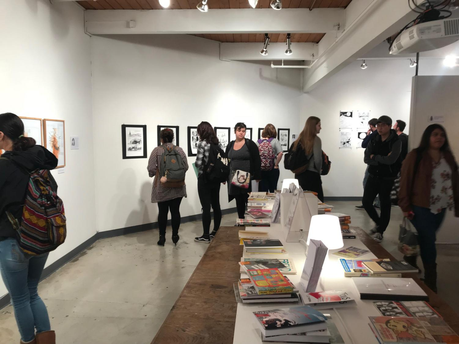 Viewers take in art at