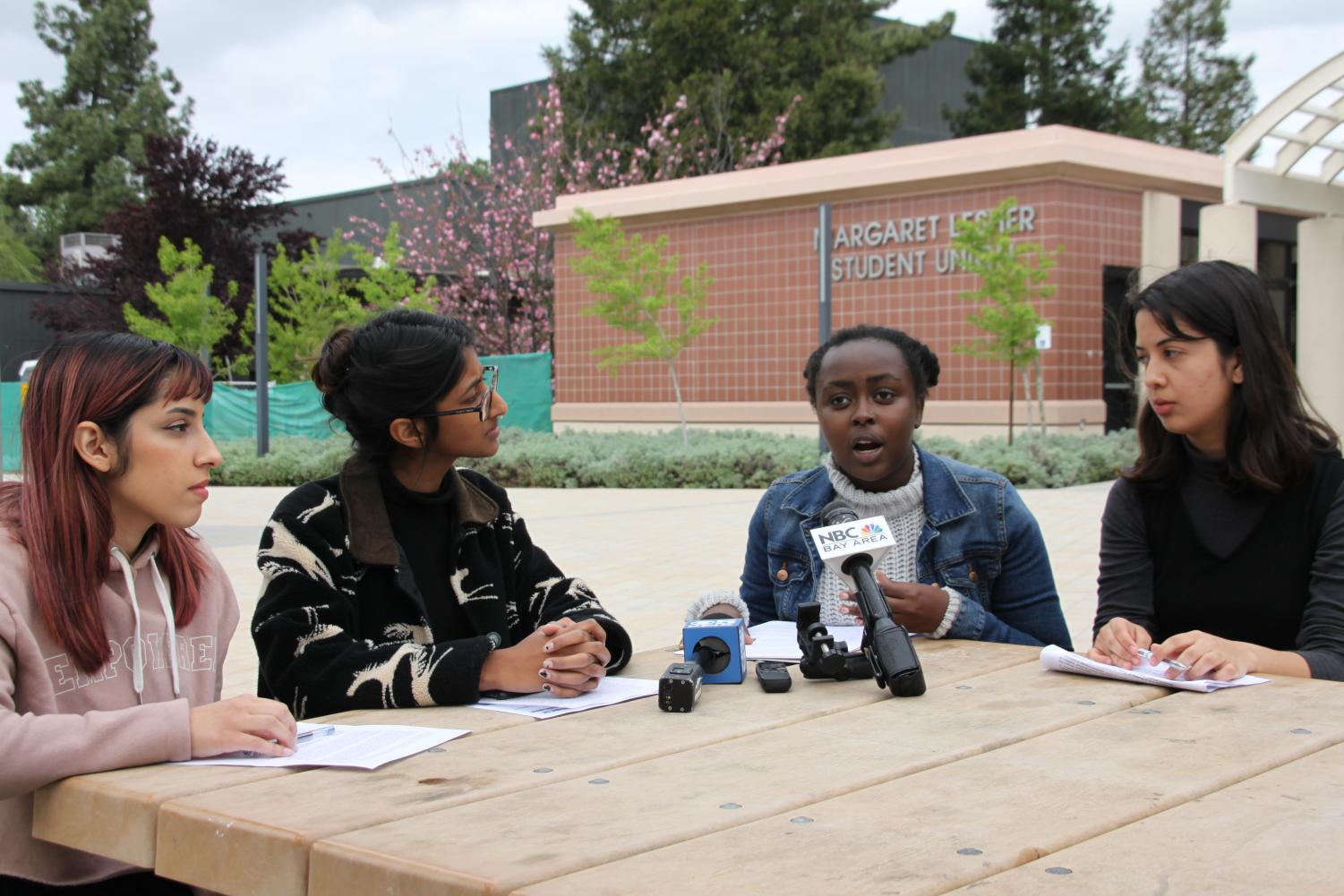 Marisol Militello, Soha Ashraf, Silvia Gathondu and Allison Morgan, left to right, from the Women's Empowerment Club hold a press conference detailing their grievances about the handling of alleged harassment from former student Gautam Reddy.