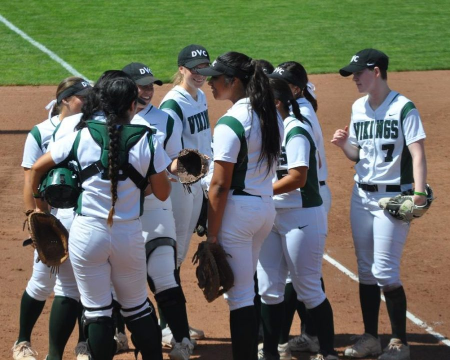 DVC softball gathers together before a game against Sacramento City in Pleasant Hill on March 31, 2018.