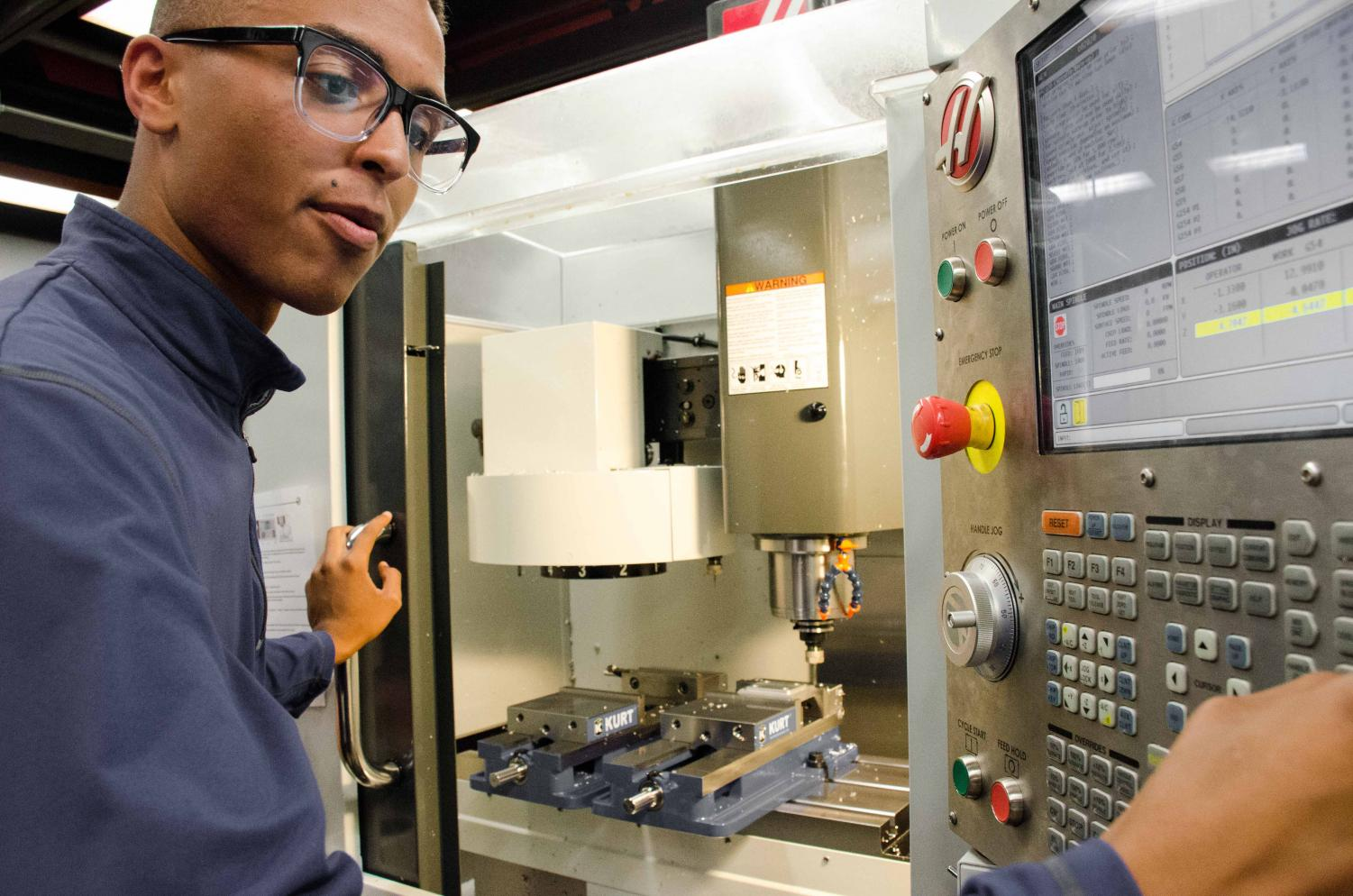 James Spencer works on an automated milling machine in the DVC machine shop on Tues, April 30th. As automated machines, like CNC ones, take over traditional manufacturing jobs, new jobs in programming and controlling them have arisen.