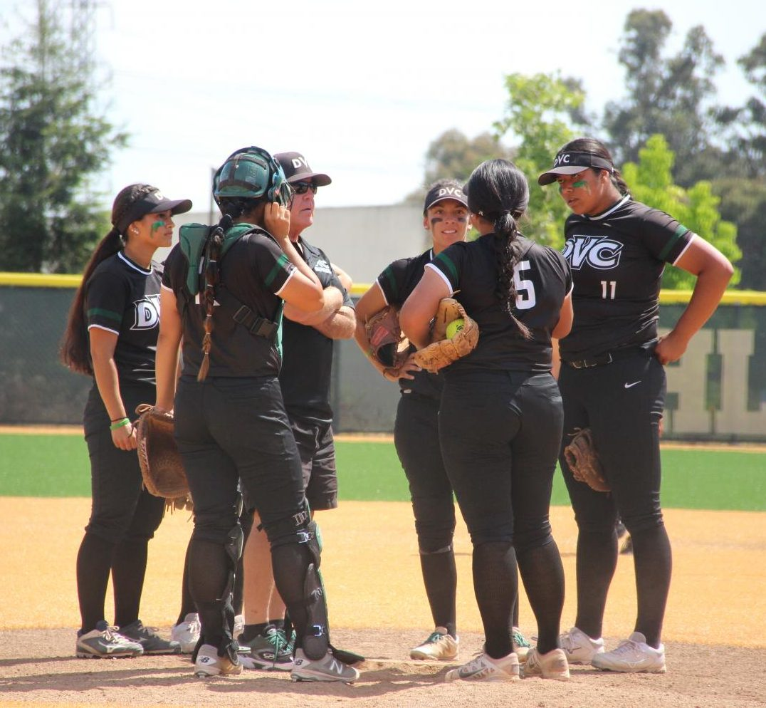 Vikings have a mound visit during their playoff game against Ohlone College in Fremont on May 4, 2018.