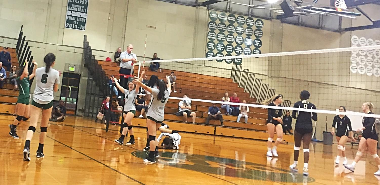 Diablo Valley College's women's volleyball team celebrates after getting a kill against Delta on Wednesday, Oct. 11, 2018. (Isabel Villalobos/The Inquirer)